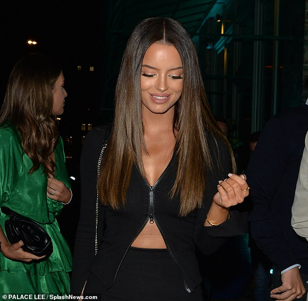 Chic:The reality personality matched her all black ensemble with a black top complete with zip detailing, while accessorising with hoop earrings