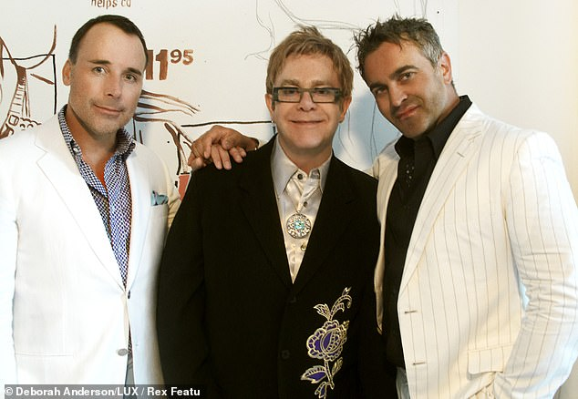 Pictured:David Furnish and Elton John at home in Los Angeles with interior designer Martyn Lawrence-Bullard