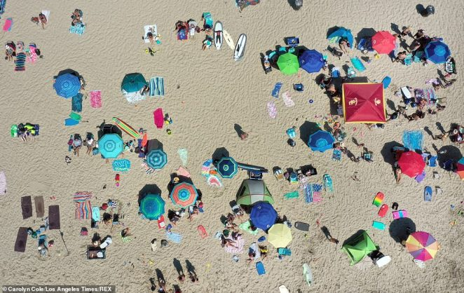 Hermosa Beach, south of Los Angeles, drew crowds of sun worshipers and people seeking respite from the hot sun