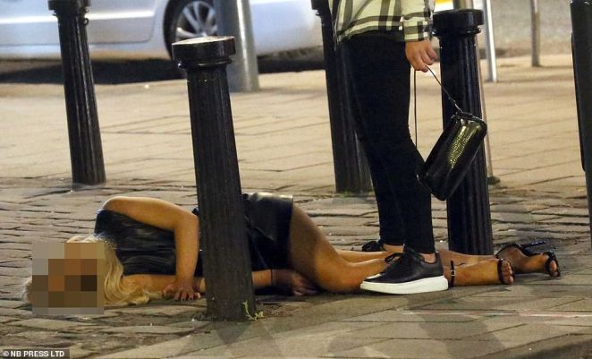 One reveller lies on the floor following a night out in the Yorkshire city which this week saw its infection rate rise to 32.4 new cases per 100,000 people