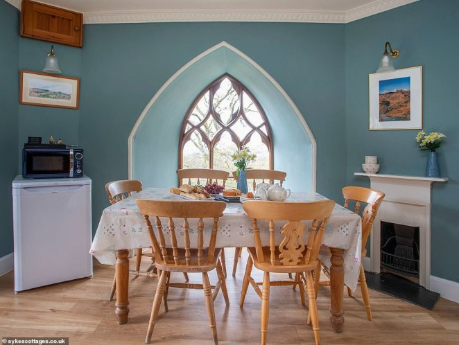 The cosy kitchen could also host a relaxing family dinner after a day or exploring the countryside (pictured)