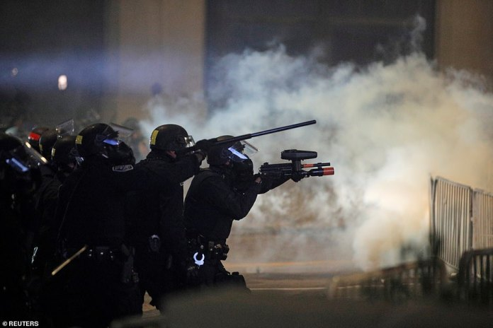 Officers with the Rochester Police Department had weapons drawn as they engaged with protesters for the fourth night in Rochester, where Daniel Prude suffocated to death in March