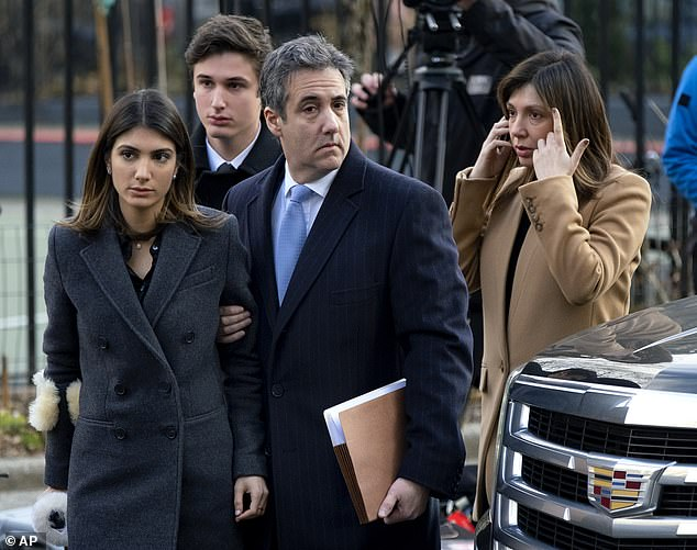 Michael Cohen, second from right, President Donald Trump's former lawyer, accompanied by his children from left, Samantha and Jake, and his wife Laura Shusterman, right, arrives at federal court for his sentencing in December 2018
