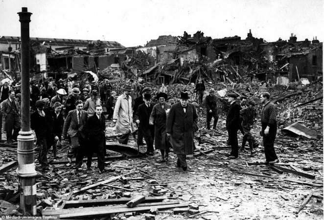 Prime Minister Winston Churchill and a small group of people inspect the air raid damage in Battersea, London, in September 1940, walking over fragments of broken brick and wood. On September 8, 1940, Battersea Power Station was shut down after a daylight attack on London the day before. An unused extension of Battersea was hit and destroyed during November but the station was not put out of action during the night attacks