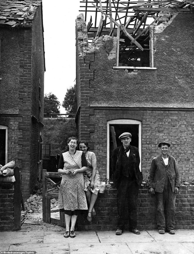 Cheery homeowners in Northfleet, Kent, pose outside their wrecked houses in 1940. Kent became known as 'Bomb Alley' during the Blitz, with thearea of land running from the Thames Estuary on the shores of Essex down to the white cliffs of Dover targeted relentlessly by the Germans. Dover, 22 miles from the French coast, was particularly badly hit, earning it the nickname 'Hell's Corner'