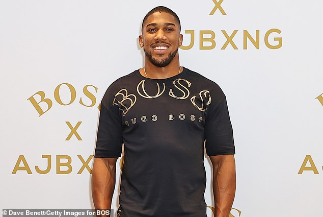 Anthony Joshua hit back at reports he has been seen spending time with Riyad Mahrez's wife