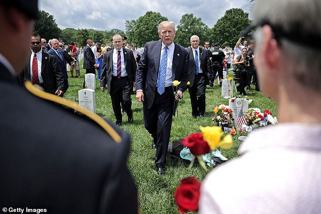 Trump was meant to join John Kelly in paying his respects to Kelly's son's grave and comfort the families of other fallen service members in Arlington Cemetery on Memorial Day, 2017 (above). However, Trump reportedly turned to Kelly and said: 'I don't get it. What's in it for them?'