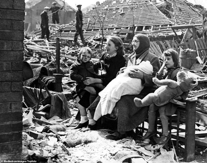 Mrs Sarah Manson, 68, sits in the wreckage of her Liverpool home after she rescued her four grandchildren (pictured) when a bomb shattered her house on May 5, 1941. Other than London, Liverpool was the most heavily bombed area of the country due to it having the largest port on the west coast, along with Birkenhead, and being of significant importance to the British war effort