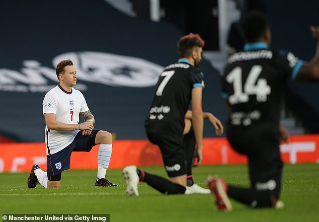 Making a statement: The captain for the England team, 36, knelt to the ground alongside the likes of Danny Jones, DJ Locksmith and Sergio Pizzorno as a symbol against racism (pictured)