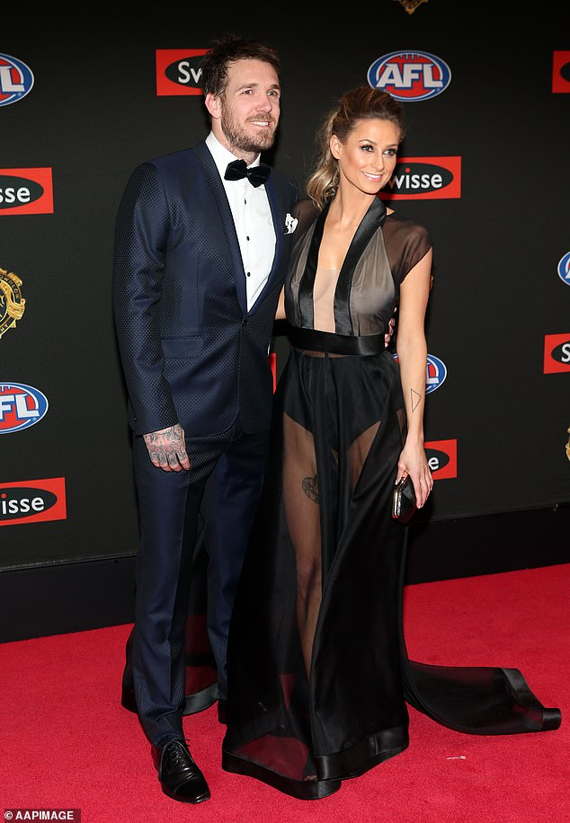 AFL legend Dane Swan has taken aim at Victorian Premier Daniel Andrews after he extended Melbourne's stage four lockdown by two weeks. Pictured with partner Taylor Wilson