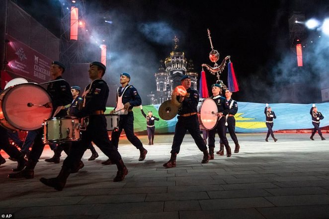 Russian paratroopers walk through the square as they perform during the festival which has moved online this year due to the coronavirus pandemic