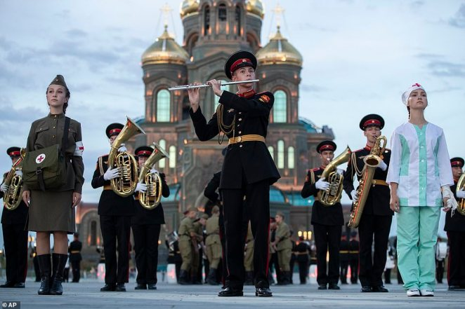 A Russian military band rehearses for the Spasskaya Tower military music festival in front of the Cathedral of Russian Armed Forces