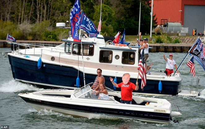 Participants in a boat parade in support of President Donald Trump enter Presque Isle Bay in Erie, Pennsylvania, on Sunday to show support for Trump ahead of the election