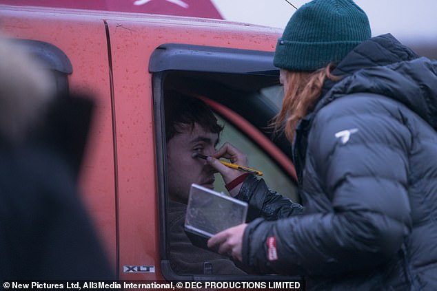 Final touches: The actor was seen in the driver's seat of a car putting on makeup and sitting in a pub as the crew made changes to the set