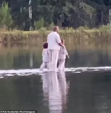 Born-again Christian:Kanye West made a dramatic entrance to his Sunday Service in Atlanta on the weekend as he appeared to 'walk on water' with daughter North, 7, and son Saint, 4