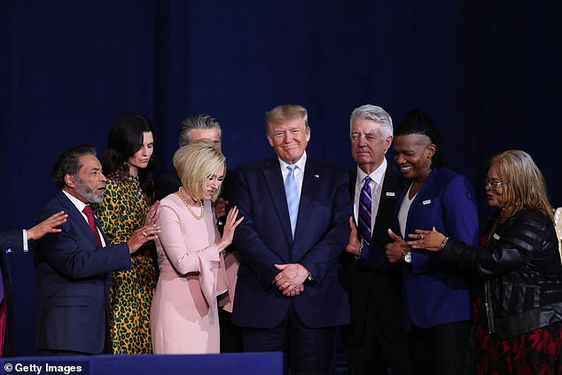 Evangelicals are pictured praying for Donald Trump in January in Miami
