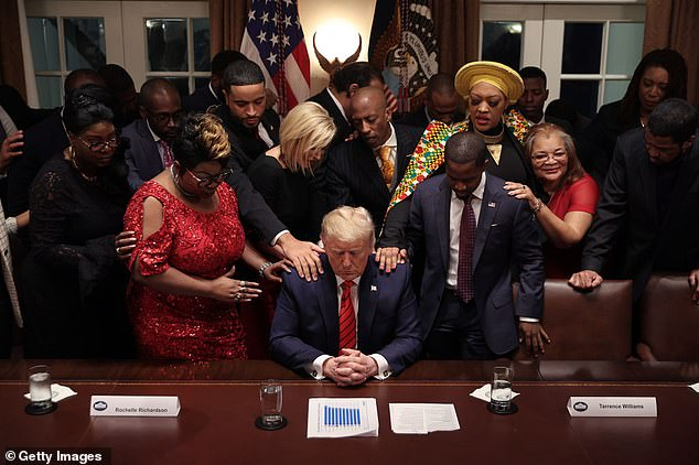 Donald Trump is pictured with faith leaders inside the White House in February