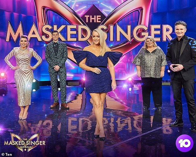 It's back! Jackie (centre) is filming the third season of The Masked Singer alongside fellow panellists Dave 'Hughesy' Hughes (right), Urzila Carlson (second from right) and Dannii Minogue (left). Osher Günsberg (second from left) is returning as host