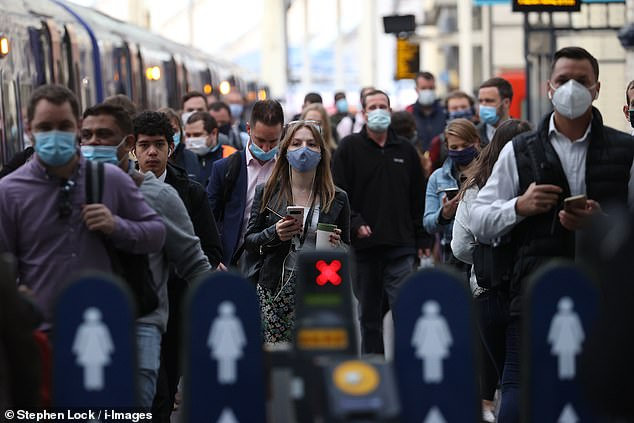 Commuters have slammed transport bosses over cancelled trains and lack of social distancing on London buses as employees head to work in Monday morning's rush hour. Picutred: Commuters arrive at Waterloo Station in London today
