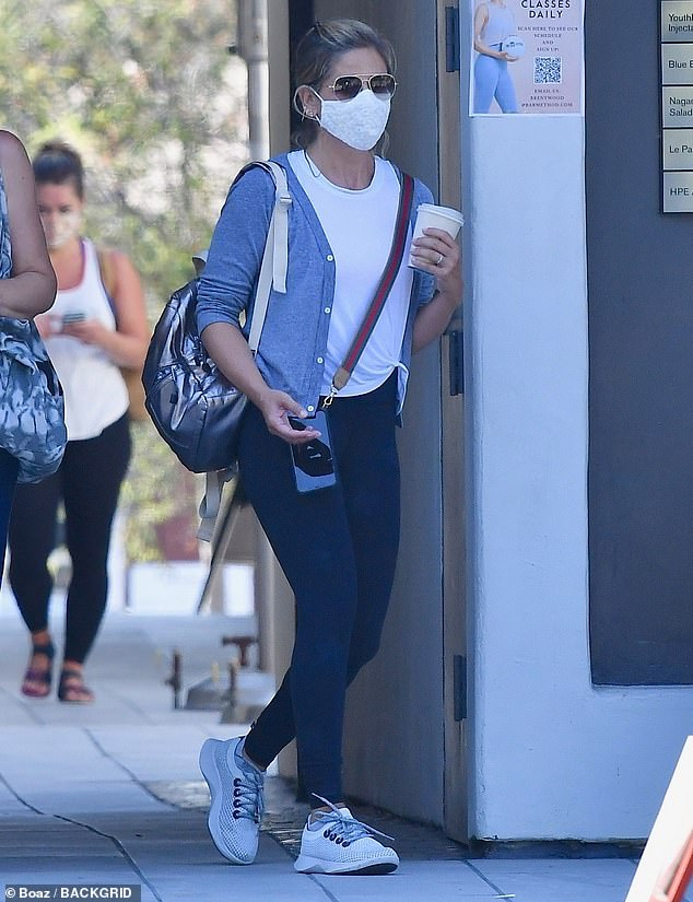 Casual: Sarah Michelle Gellar opted for a laid back look as she attended an outside exercise class with some pals in the Brentwood neighbourhood of LA on Sunday