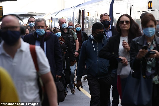 It comes as train services are ramped up from today to 90 per cent of pre-Covid levels as schools reopen and more workers return to the office. Pictured: Commuters arrive at Waterloo Station