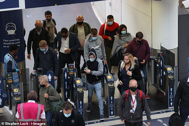 The commuters, all wearing face coverings, as required by law, were queuing to get through the ticket gates at the busy railway station - a scene not often witnessed since the country was plunged into lockdown