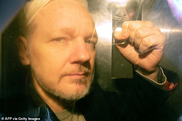 Julian Assange, pictured in May 2019, faces 18 charges - including plotting to hack computers and conspiring to obtain and disclose national defence information