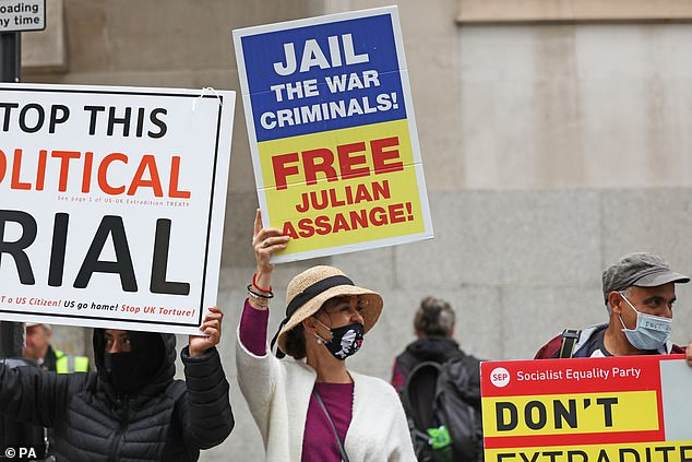 Demonstrators roared in applause as speeches demanded the Government free Assange, while some banged drums and carried banners