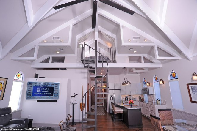 The floating chapel has retained many of its original features including a 30-feet steeple, seven stained-glass windows and 19-foot ceilings (interior pictured)