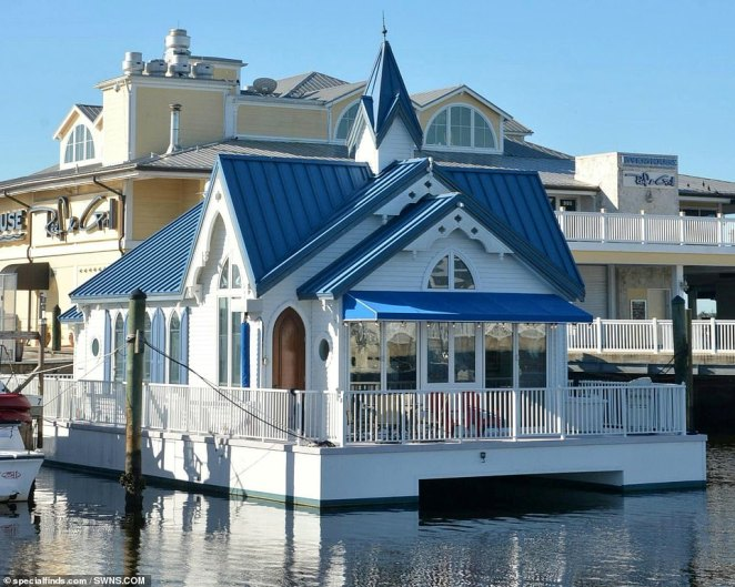 The 1,050 square foot home sits on an 1,800 square foot barge and weighs a colossal 33 tons (exterior of the one-of-a-kind home pictured)