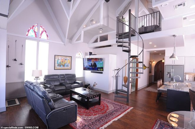 More than $1,300,000 has been spent on the original construction in 2004 and subsequent conversion over the years (open-plan living area pictured)