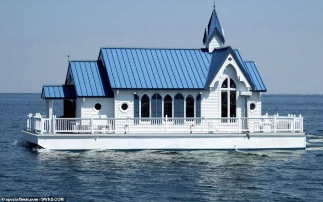 A floating chapel that was recently transformed into a luxury two-bedroom houseboat (pictured) has been put on the market for $400,000