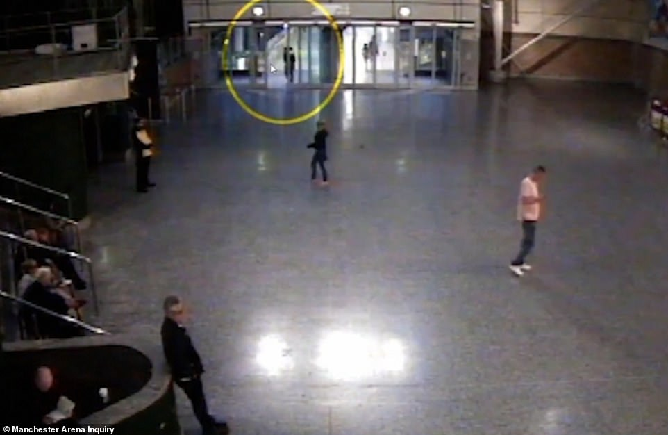 On May 21, the day before the attack, footage shows Abedi walking into the arena's City Room area (pictured) before sitting on a stairwell leading up to a mezzanine area - apparently on his phone