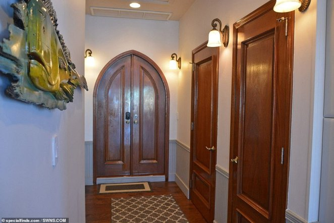 The solid hardwood doors and floors (pictured) have been kept to retain the character of the old chapel despite the recent renovation into a floating home