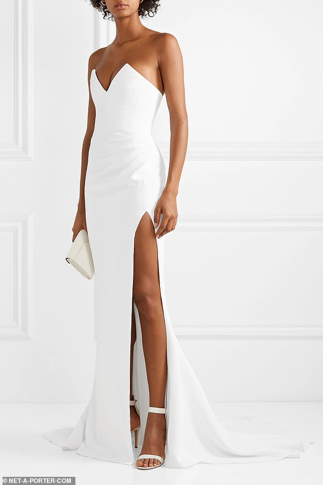 BEST FOR BRIDES WITH A BIG BUDGET: Crafted from white crepe, this gown has a sweetheart neckline, nipped-in waist and gently ruched side that highlights the thigh-high split. The long train will glide beautifully down the aisle. This version is available via net-a-porter.com