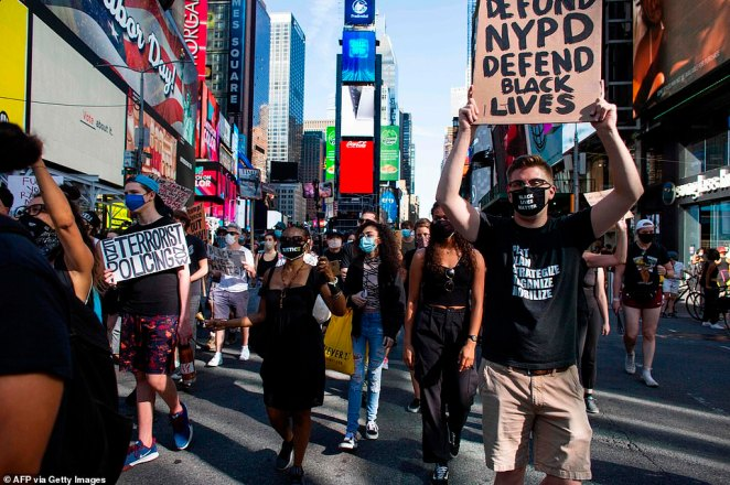 NEW YORK CITY: Demonstrators in Manhattan marched for the defunding of the police and to say that Black Lives Matter