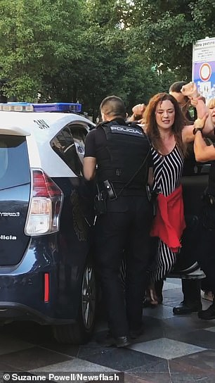 The unidentified woman was detained in the Spanish capital on Saturday during protests by hundreds of coronavirus deniers.