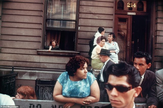 In 1962, when Meyerowitz first went out to document New York City street life, he went with other photographers, like Tod Papageorge and Garry Winogrand. He often took pictures while people were watching parades, such as the image above, New York City, 1963. He noted the girl in the window with her arm flung out and the man with with the dark glasses in the picture's foreground. He told DailyMail.com: 'I was learning to make pictures that were more demanding'
