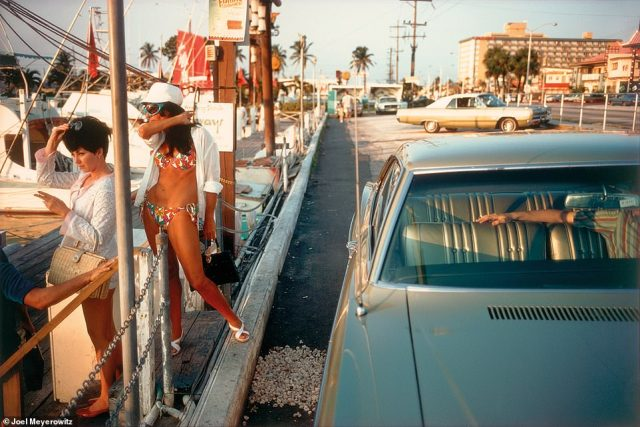 When Meyerowitz attended Ohio State University to study medical illustration, art history and painting, he worked as a waiter in the Catskills during his summer breaks. After he graduated in 1959, he went to Florida and landed a job as maître d' at a hotel. 'I had the time of my young life,' he recalled. For the above image, Florida, 1967, he explained that he had been at the marina looking for a commercial shoot location when he saw the two women, the pebble walkway and the outstretched arm, which he called slightly ominous, and decided to take a picture