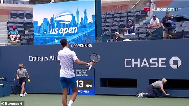 Djokovic was frustrated and fired a ball behind which struck the line judge in the throat