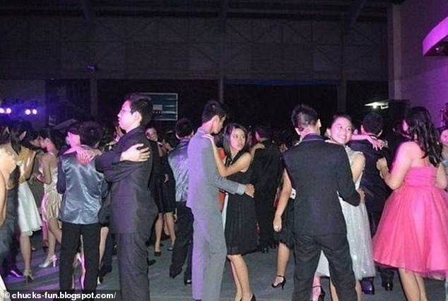 Another singleton, from an unknown location, was snapped hugging himself as he danced among the crowd of couples at a Christmas event