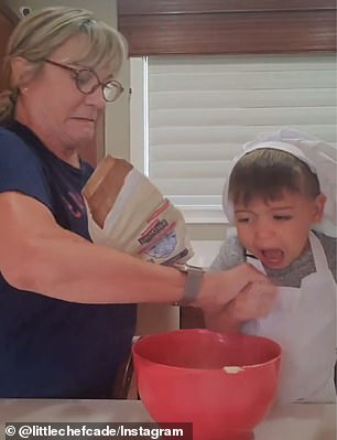 The hungry toddler wants to try every ingredient as he goes