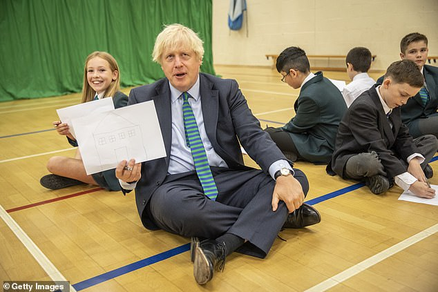 A school visited by Boris Johnson on August 26 (pictured) ¿ Castle Rock High School in Coalville, Leicestershire ¿ put a number of pupil groups into self-isolation ¿as a precaution¿ after a staff member tested positive