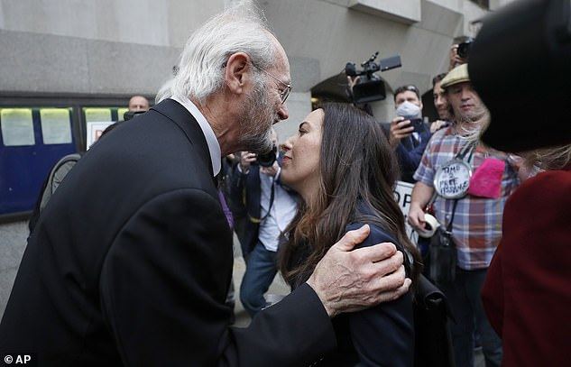 Mr Assange's father, John Shipton, Ms Moris, greeted one another outside the court