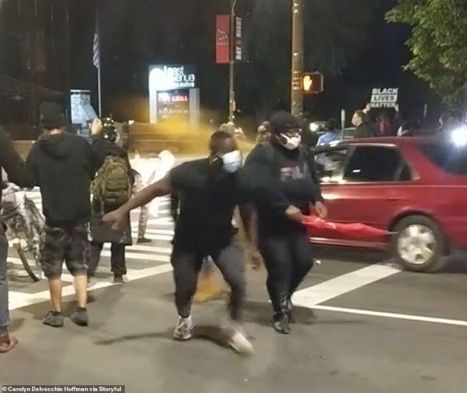 The driver of the vehicle was spraying yellow paint at demonstrators as he drove through the crowd and hit the unidentified man on Friday night in Rochester, New York