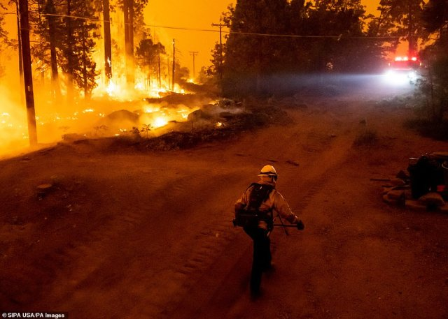 Firefighters, pictured on Monday, have been working around the clock to put out the Creek Fire in northern California