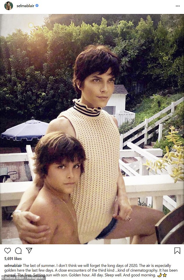 'The last of summer': Selma Blair posted a photo of herself with son Arthur, nine, in which they posed in the backyard of their home in what the actress described as a 'golden' light