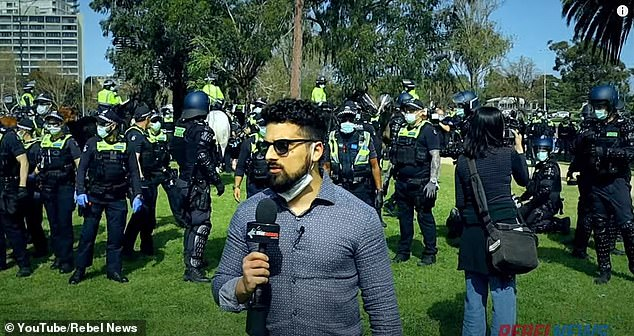 Yemini, who was reporting for Rebel News with a media pass, was doing a piece to camera in Albert Park on Saturday as police clashed with protesters