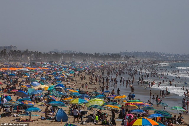 SANTA MONICA, CALIFORNIA: People gather on the beach on the second day of the Labor Day weekend amid a heatwave in Santa Monica, California on Sunday