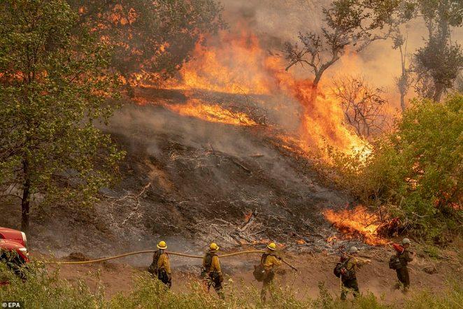 The El Dorado Fire burns a hillside near Yucaipa in the San Bernardino National Forest on Monday